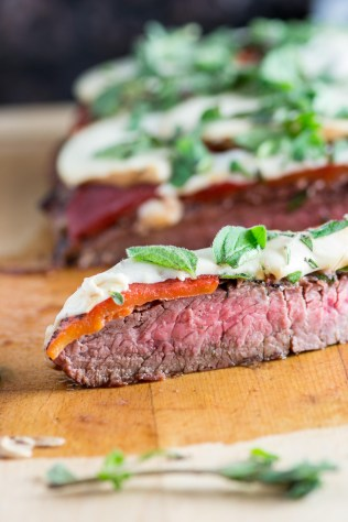 Grilled Flank Steak Smothered with Prosciutto, Roasted Red Peppers, and Smoked Mozzarella